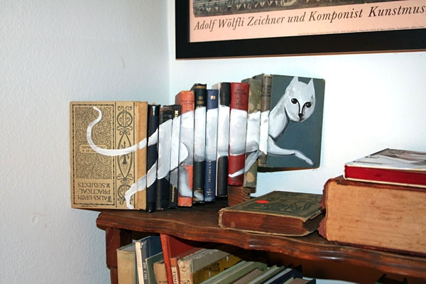 14-Mike-Stilkey-Books-used-as-Canvasses-for-Paintings-www-designstack-co