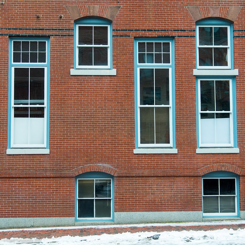 Portland, Maine USA February 2018 photo by Corey Templeton. A curious grouping of asymmetrical Windows on Pearl Street.