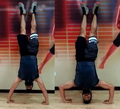 Flexiones de cabeza parado de manos para hombros y trapecio