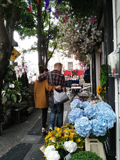 couple looking at flowers
