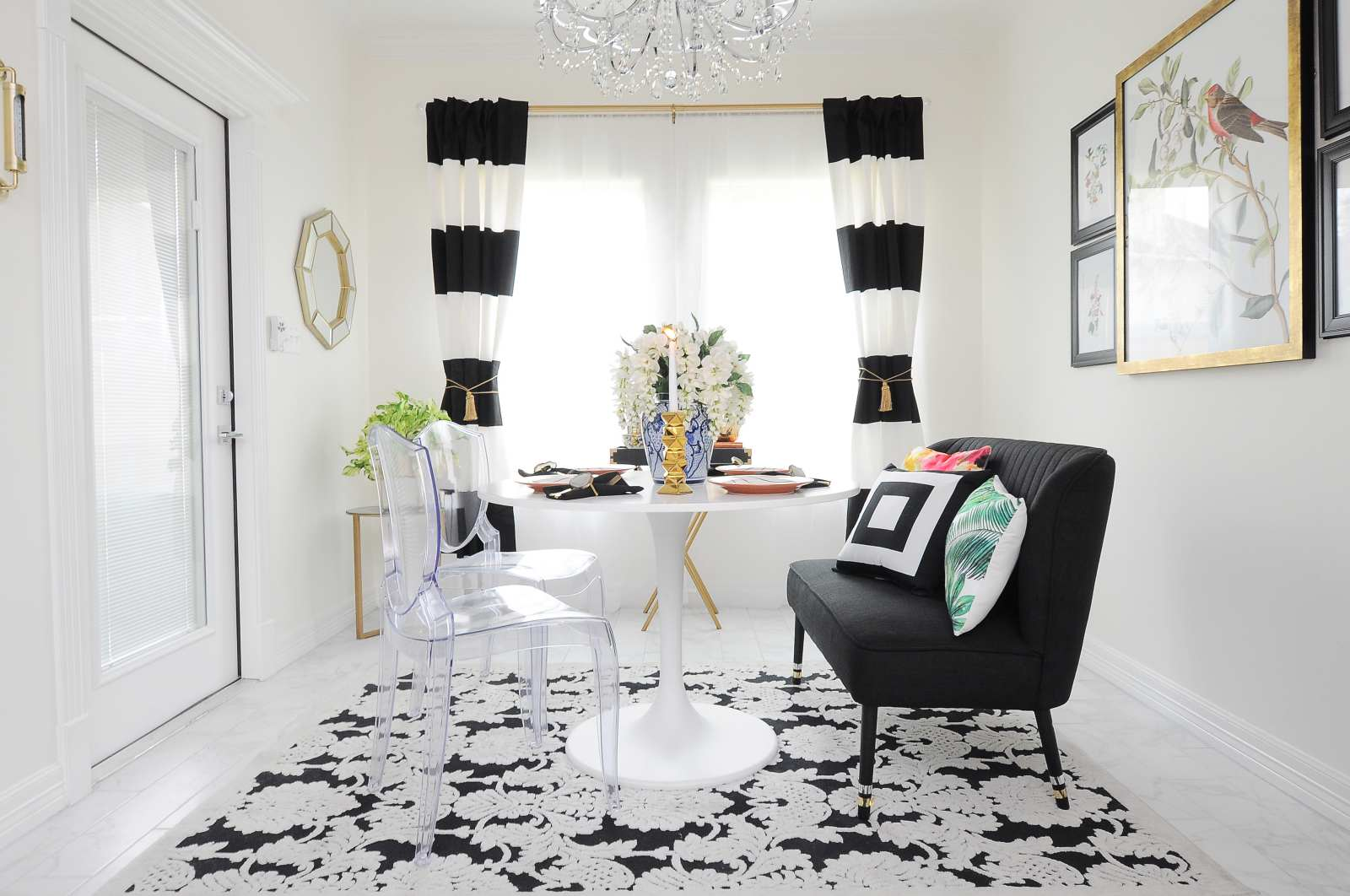 A $100 dining room makeover with gorgeous black, white and gold accents. Love all the botanical and audubon touches.