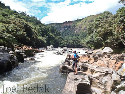 Chris Baer Scouting the entrance rapid on the Estrecho section of the Rio Magdalena, Colombia, Joel Fedak