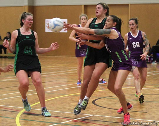 Front L-R: Kelsey McPhee (GA), Kaya Lord (GS), Otane; Barbara Thompson (GK), Nina Pineaha (GD), All In - netball at Woodford House, Havelock North, Otane beat All In 58-30. photograph
