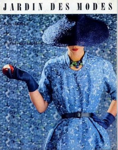 Model in Christian Dior 1951 Ad wearing hat in same fabric with backdrop in same fabric
