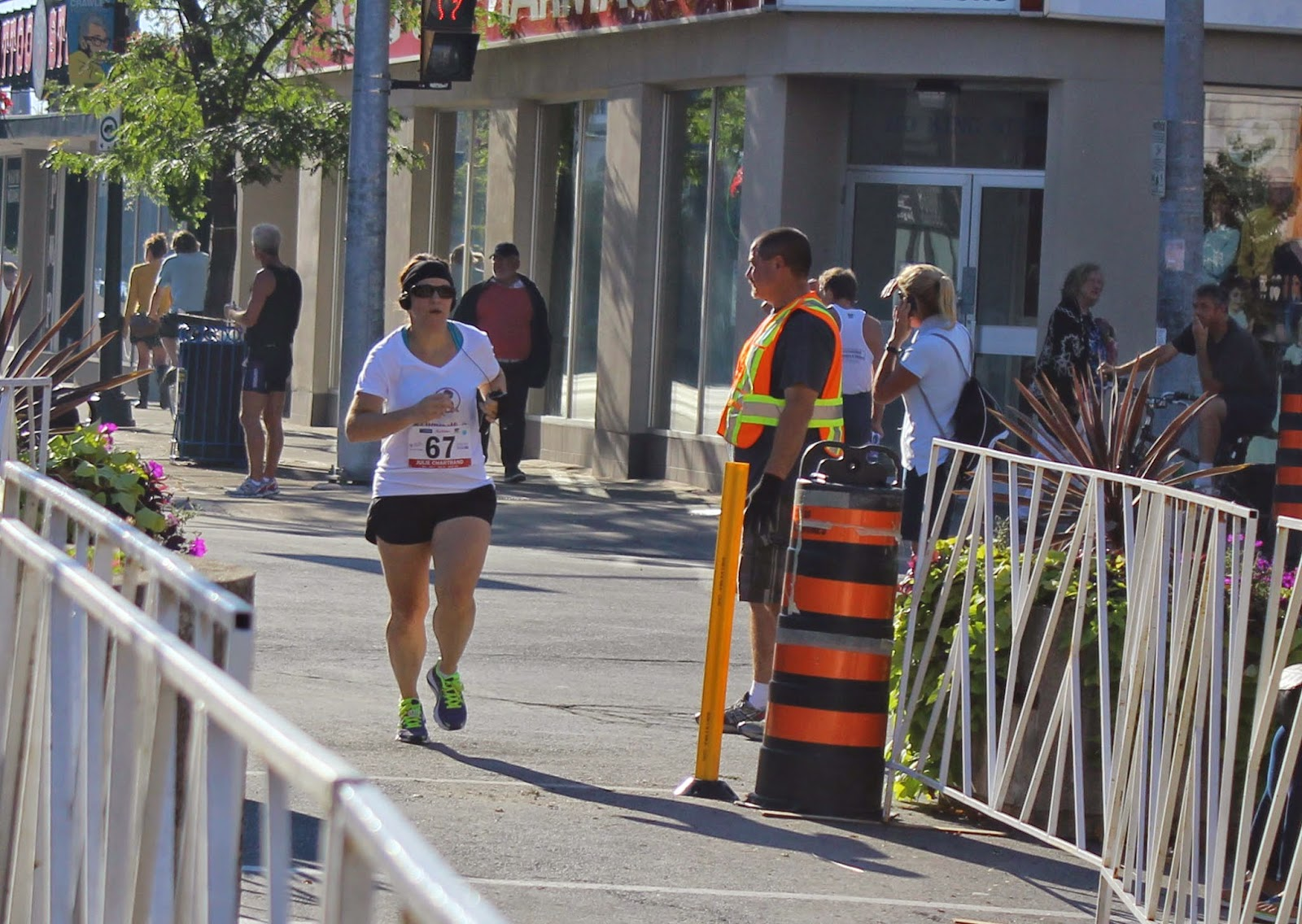 Photo of Julie crossing finish line
