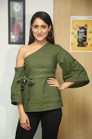 Pragya Jaiswal in a single Sleeves Off Shoulder Green Top Black Leggings promoting JJN Movie at Radio City 10.08.2017 082.JPG