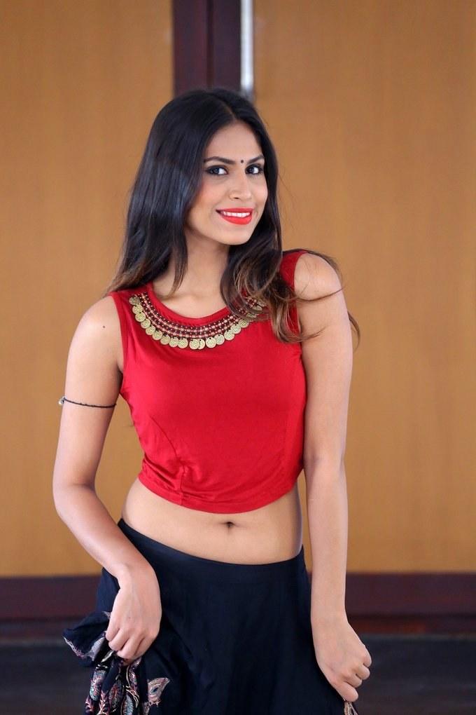 Glamorous Hyderabad Girl Nishi Ganda Hip Navel Show Photos In Red Dress