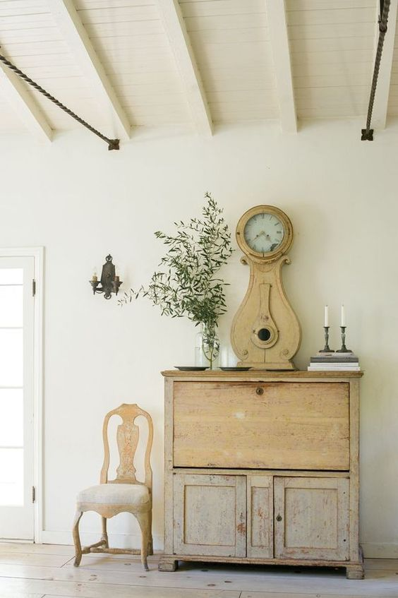 Swedish antiques in beautiful room with elegant decor - found on Hello Lovely Studio