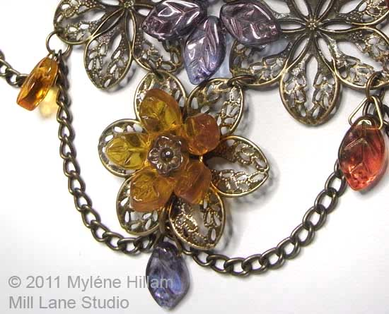 Pressed Czech leaf beads in muted autumn tones look wonderful against soft brassy metal filigrees.