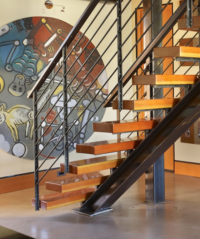 Close up photo of steel and wooden stairs in floating home