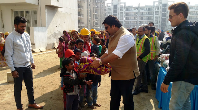 Mr Arman Chaudhary,Chief of HR,Emaar India at the Clothes  Distribution Drive for labourers at Palm Terraces Gurugram 01