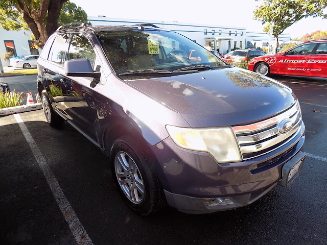 2008 Ford Edge after body repairs & color change at Almost Everything Auto Body.