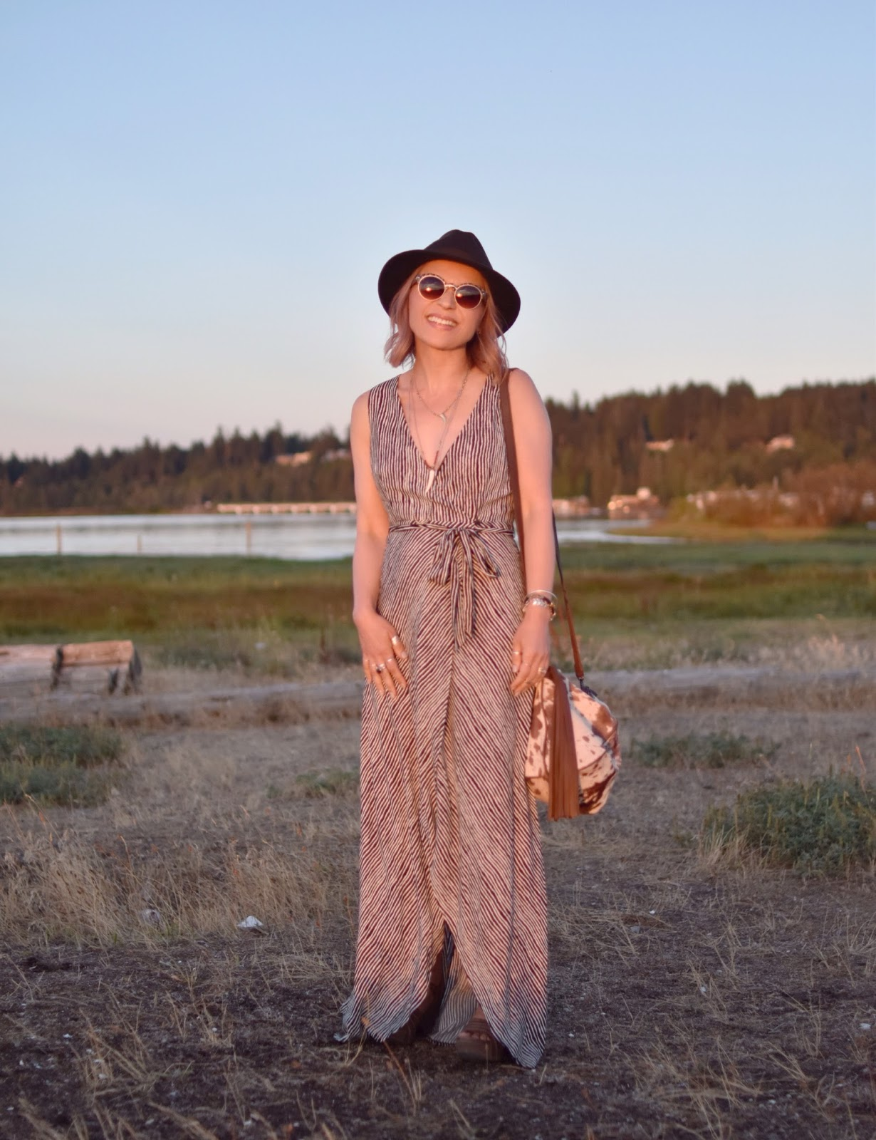 Monika Faulkner personal style inspiration - black and white striped maxi-dress, brown felt fedora, animal-patterned sunglasses, pony-hair bag