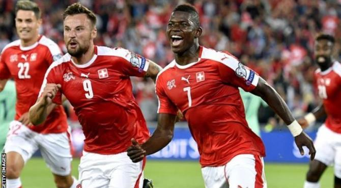 Switzerland beat European champions Portugal 2-0 in their opening World Cup 2018 Group B qualifier on Tuesday.  Breel Embolo and Ahmed Mehmedi scored first-half goals for the hosts, who had Arsenal midfielder Granit Xhaka sent off in stoppage time.  Portugal were missing Cristiano Ronaldo, with the Real Madrid forward injured since July's Euro 2016 final.  Beaten finalists France got their own campaign off to a slow start with a 0-0 Group A draw in Belarus .  Elsewhere in that group, Sweden held the Netherlands to a 1-1 draw with a Wesley Sneijder goal cancelling out a chip from Marcus Berg, while Bulgaria beat Luxembourg 4-3 thanks to an injury-time winner from former Aston Villa winger Aleksandar Tonev.