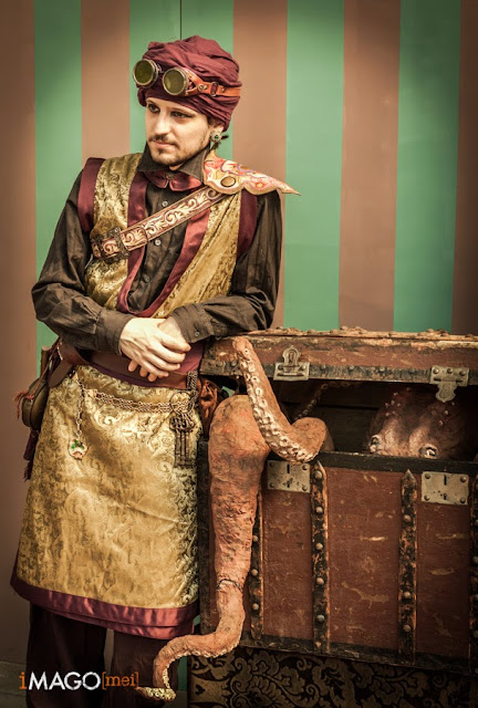 Man dressed in a middle eastern steampunk costume with a turban and goggles. Men's ethnic, multicultural steampunk costumes and clothing.