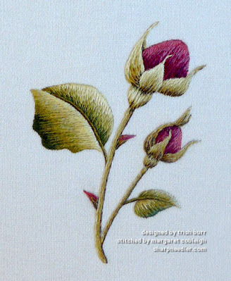Thread painting example of rosebuds designsd by Trish Burr
