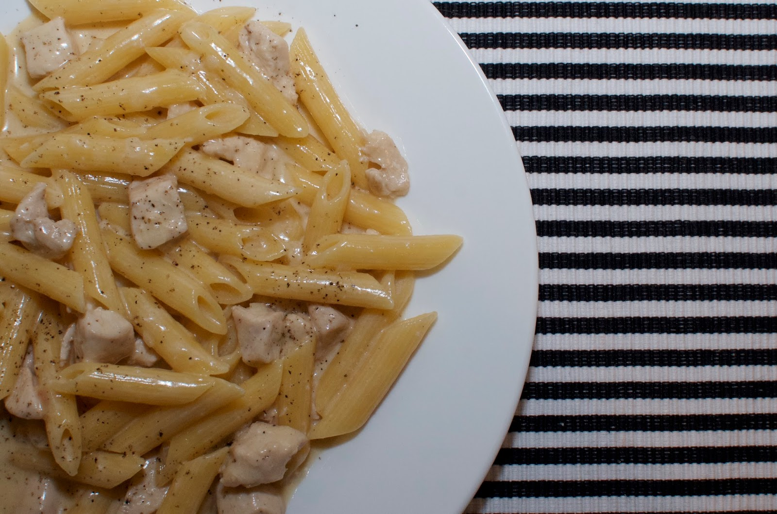 Mushroom-Free One-Pot Creamy Chicken Marsala & Penne on black & white striped placemat with white plate