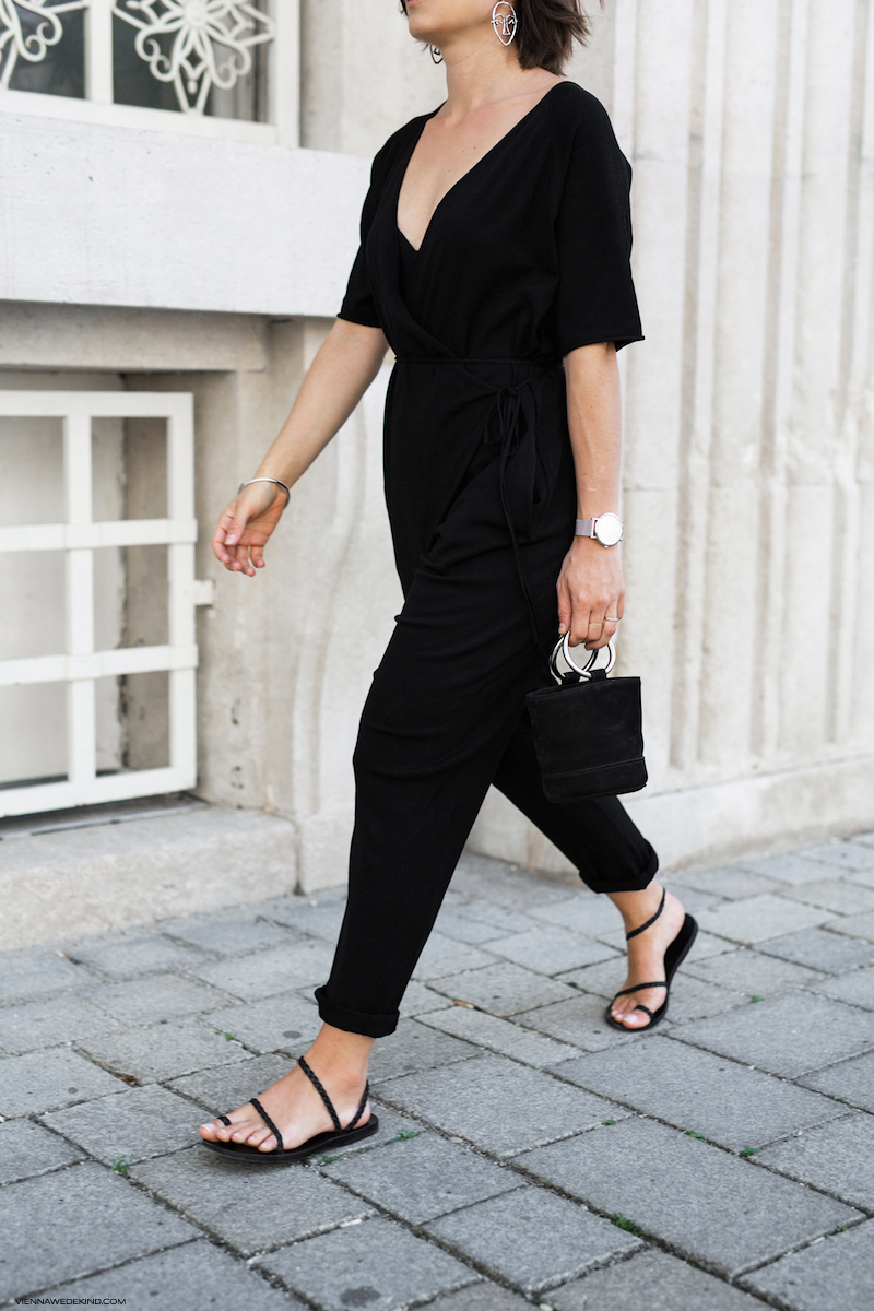 Easy Spring or Summer Outfit Idea: Black Jumpsuit, Mini Bag, and Strappy Flat Sandals