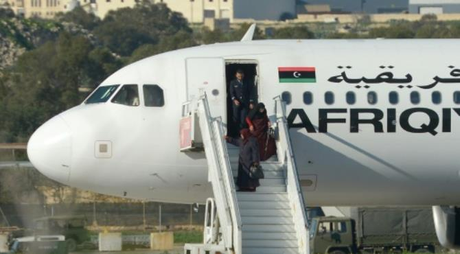 A group of hostages is released from a hijacked Afriqiyah Airways plane in Malta on December 23, 2016