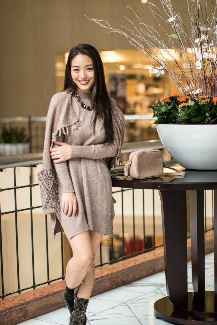 asian blogger wears mock neck tunic
