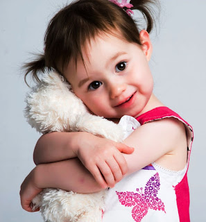 pics of cute baby girl with toy animal for whatsapp dp
