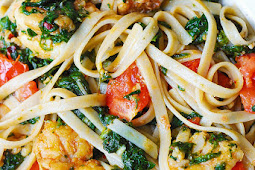 Shrimp, tomato, and spinach pasta in garlic butter sauce