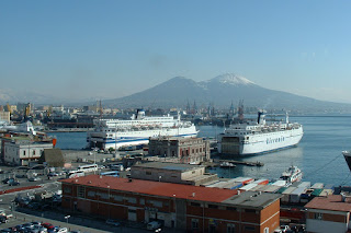 The Port of Naples, with two cruise ships dwarfing the  Palazzo dell'Immacolatella in the centre of the picture