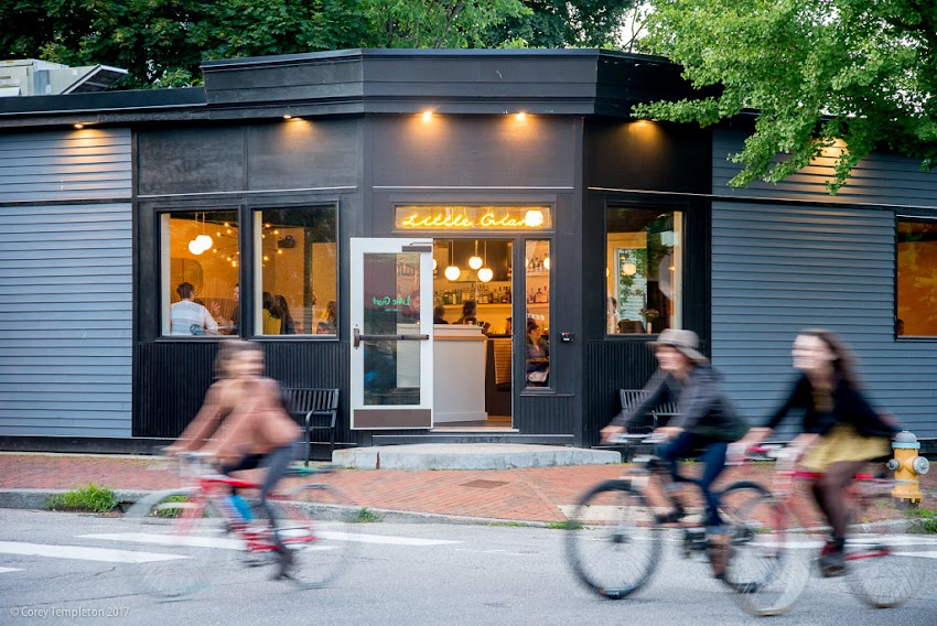 Portland, Maine USA July 2017 photo by Corey Templeton. A trio of bikes passing by the newly opened Little Giant restaurant at the corner of Danforth & Clark Streets in the West End.