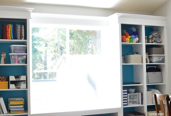 colorful built in bookshelves for master bedroom and craft room