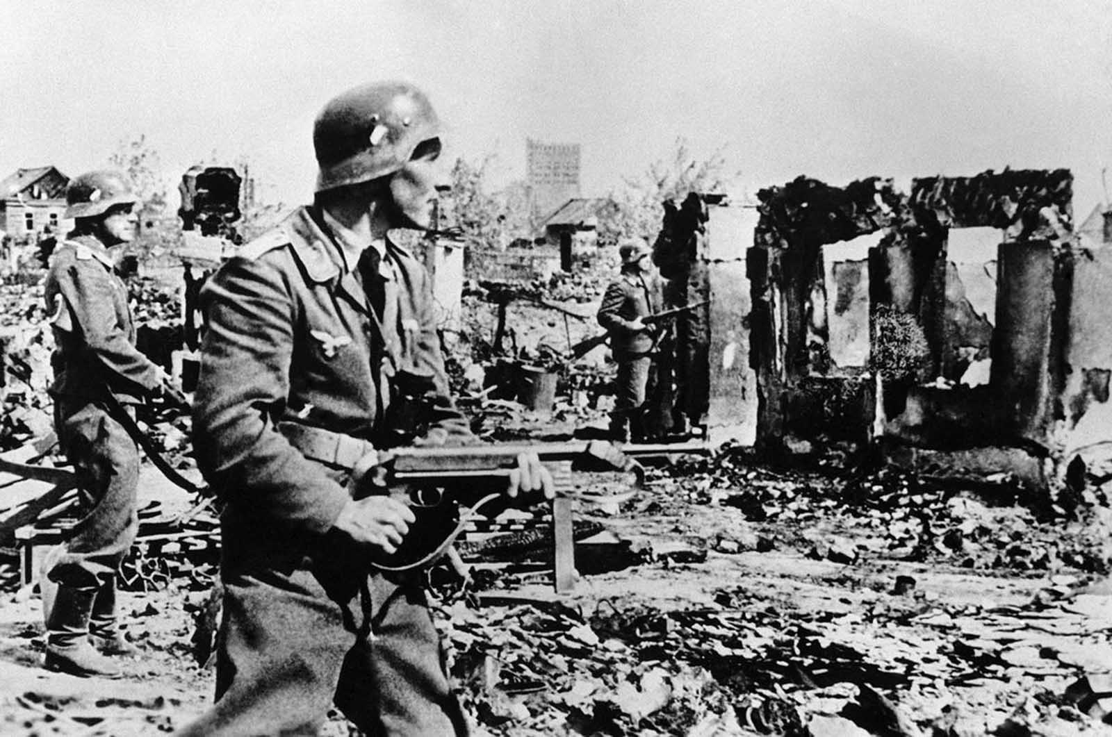 German troops involved in street fighting in the destroyed streets of Stalingrad in early 1943.