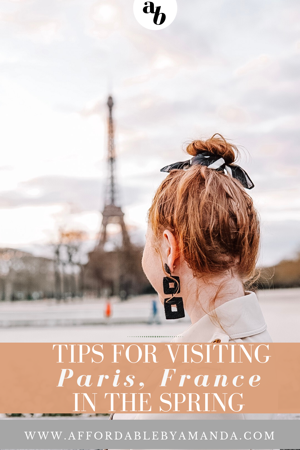 tampa blogger amanda burrows of affordable by amanda gives her tips for visiting paris, france in the spring. she is standing in the city looking over at the Eiffel Tower. She is wearing henna drop earrings in black from BaubleBar.