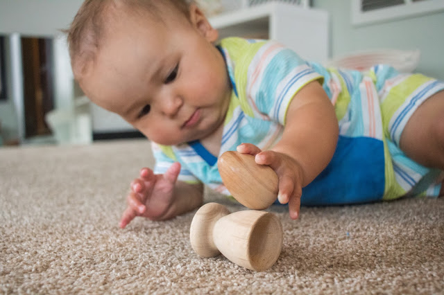 A look at the egg and cup, a classic Montessori baby toy. This beautiful, simple toy is a perfect fine motor toy for babies.