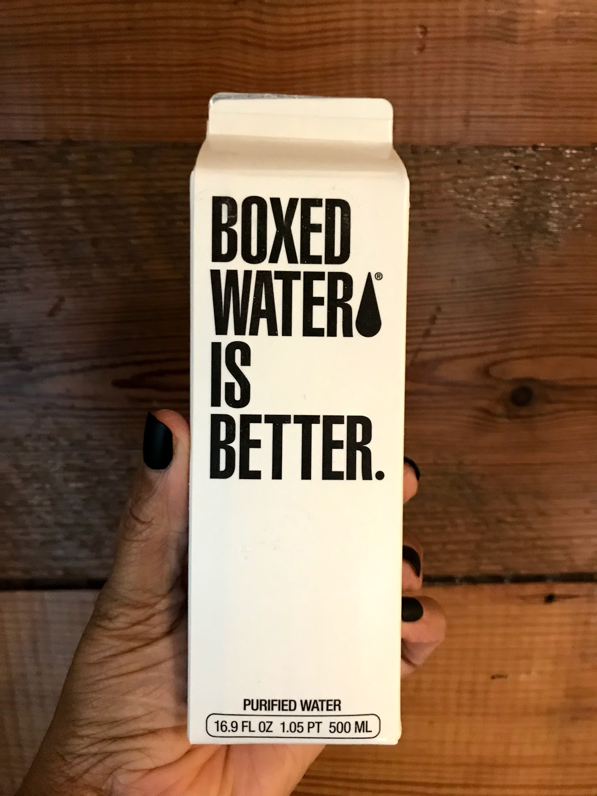 Image:Box water on bits and babbles blog. Woman holding as she shares her aging story