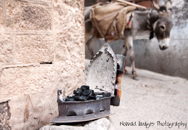 primitive iron filled with hot coals on city streets