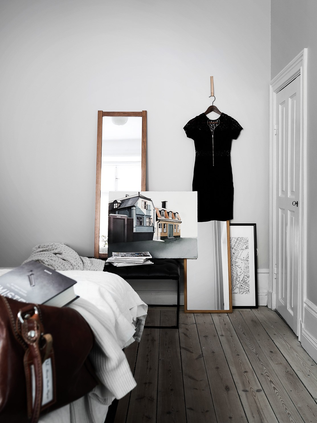 high ceilings apartment with wooden floors, white painted walls, danish design, bedroom