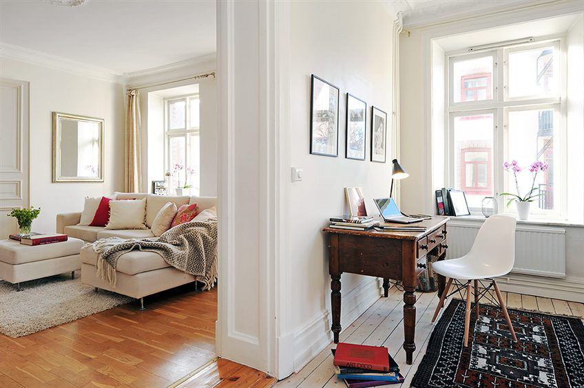 Gorgeous Swedish style desk area with neutral romantic decor in Stockholm apartment