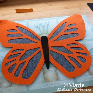 Black, gray and orange Halloween style butterfly design