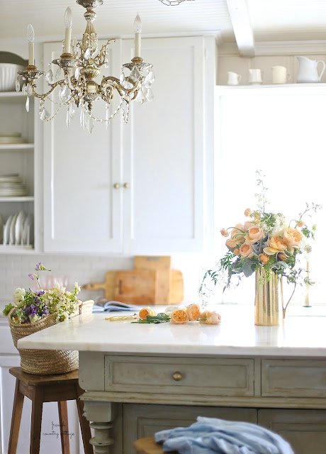 peach roses in white kitchen