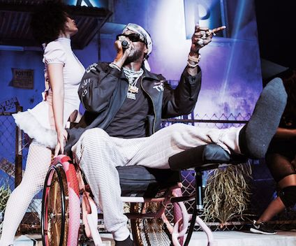 "2 Chainz Breaks Leg, Continues Tour In Pink ""Trap"" Wheelchair"