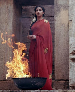 Keerthy Suresh in Red Saree with cute Expressions in Mahanati Working Stills