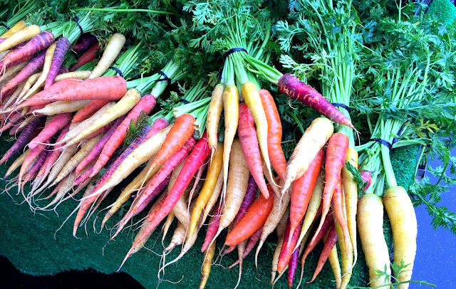 Rainbow carrot bunches, Hollywood Farmers Market, Los Angeles.