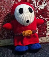 http://www.ravelry.com/patterns/library/shy-guy-amigurumi-pattern