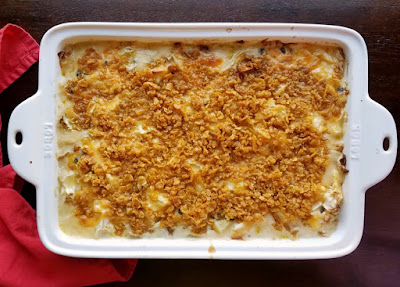 baked cheesy cabbage casserole with buttery corn flake topping