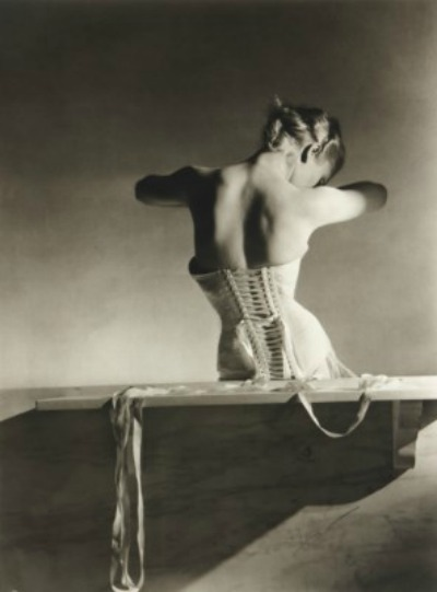 Back view of model wearing a corset designed by Mainbocher and photographed by Horst P. Horst