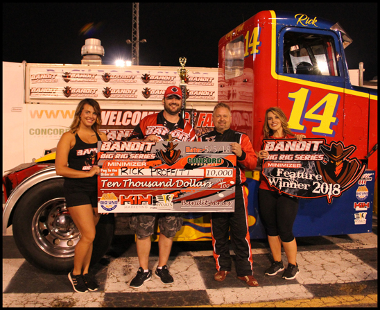 A-main feature race winnner Ricky 'Rude' Proffitt (second from right)  poses with his $10,000 check at the Bandit Big Rig Series event at  Concord Speedway Saturday, May 5, 2018