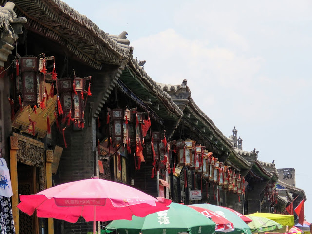 Red lanterns and umbrellas in Pingyao China