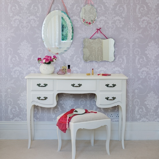 small vanity table with three mirrors and storage with small stool