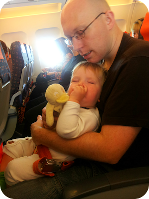 father and son asleep together, toddler on a plane