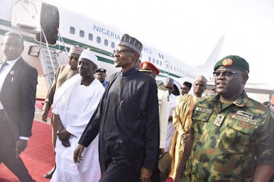 president buhari walking in the airport
