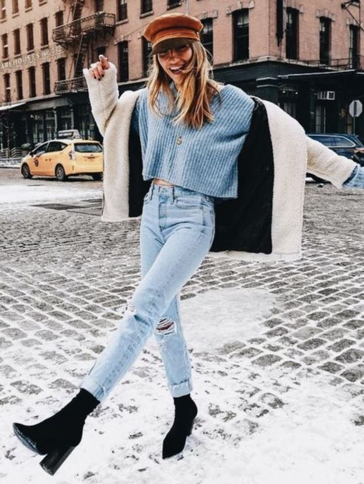 winter outfit inspiration / hat + blue sweater + white fur jacket + jeans + boots